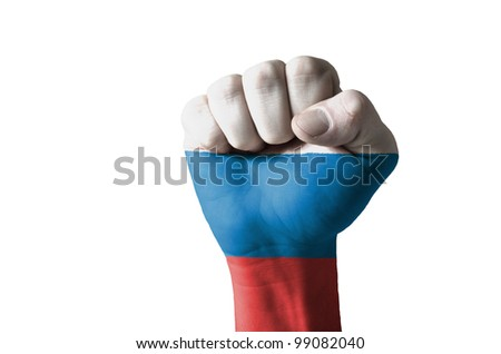 Low key picture of a fist painted in colors of russia flag - stock photo
