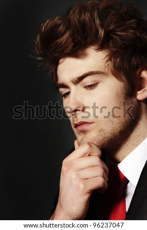 low key portrait image of business man who looks deep in thought