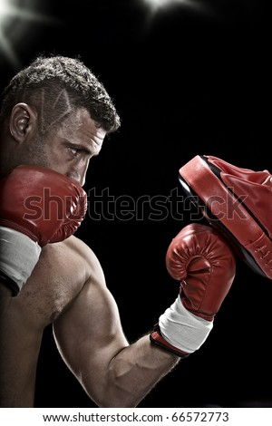 low key portrait of boxer getting ready for fight - stock photo