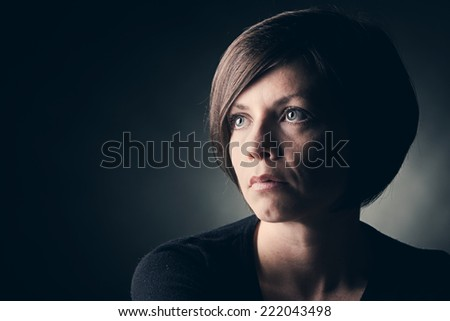 Low Key Shot of 30s Female - stock photo