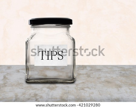 Low paid workers etc. Empty tips jar, service industry. - stock photo