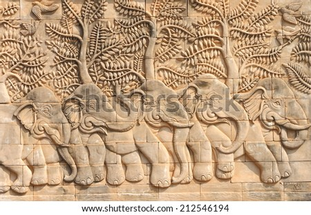 Low relief cement Thai style handcraft of elephant stories. - stock photo