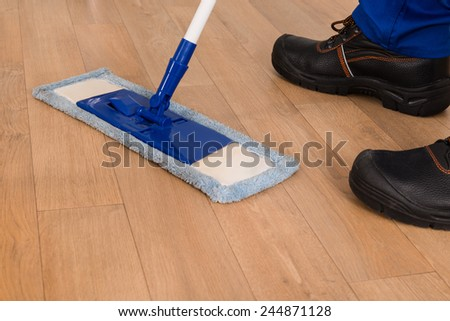 Low Section Of A Janitor Mopping Floor - stock photo