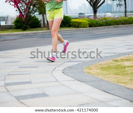 Low section of a running woman. - stock photo