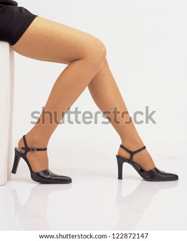 Low section of woman sitting