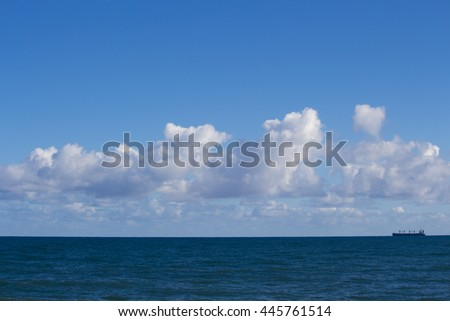 Low  stratocumulus clouds over the Indian Ocean at Ocean Beach Bunbury Western Australia on a cold morning in winter create a pleasant seascape.