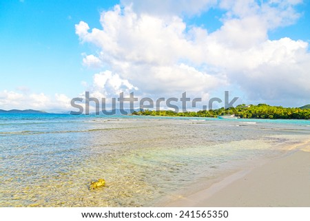 Low tide at sunset on Lindquist Beach, US Virgin Islands. Beautiful beach on St Thomas Island and other islands on horizon. - stock photo
