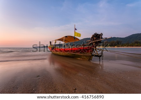 Low tide during sunset on Kamala beach in Phuket Thailand - stock photo