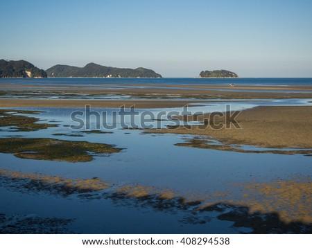 Low tide in Marahau with views to Abel Tasman - stock photo