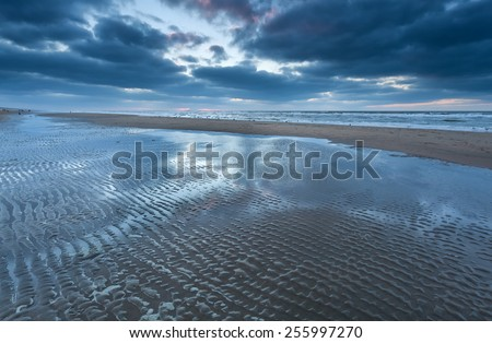 low tide on North sea beach, Holland - stock photo