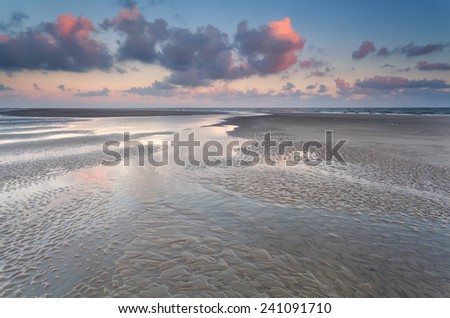 low tide on North sea during sunrise, Holland - stock photo