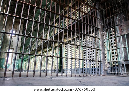 Low view showing how the prison bars are setup when the prisoners are locked away - stock photo