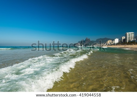 Low Waves on the Sand of Ipanema Beach in Rio de Janeiro - stock photo