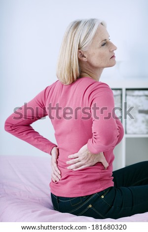 Lower Back Pain In Elderly Person - stock photo