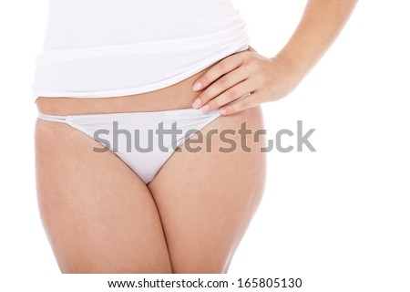 Lower body of an attractive woman in underwear. All on white background.