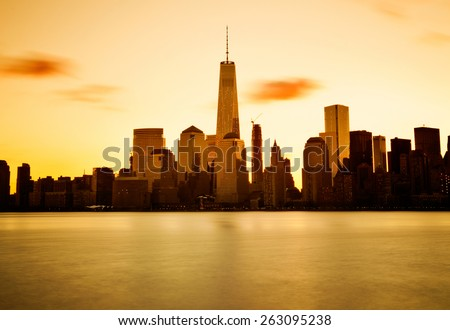 Lower Manhattan in New York City at sunrise - stock photo