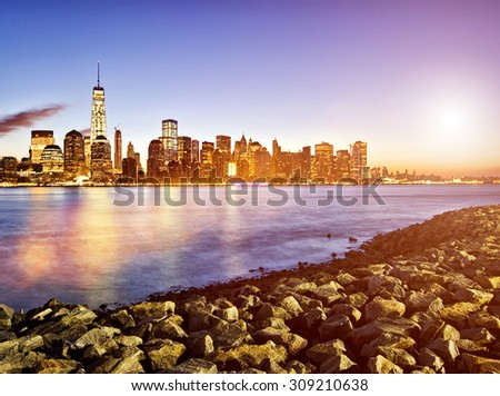 Lower Manhattan in New York City at sunrise - stock photo