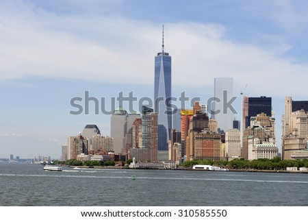 Lower Manhattan, New York skyline with Freedom Tower and Hudson River at June 2015 - stock photo