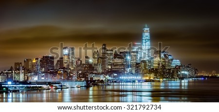 Lower Manhattan on a cloudy night, viewed from Weehawken, New Jersey - stock photo
