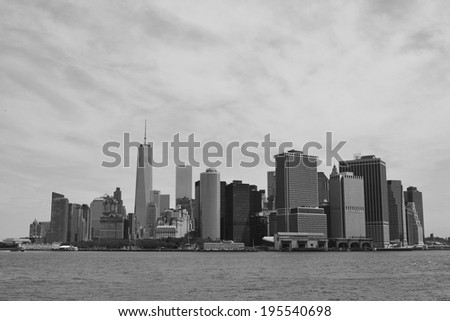 Lower Manhattan skyline and New York Harbor as seen from Governors Island. - stock photo