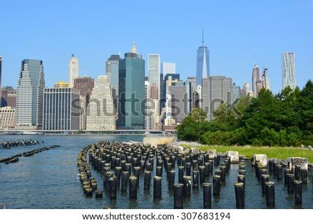 Lower Manhattan skyline as seen from Brooklyn Bridge Park. - stock photo