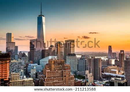 Lower Manhattan skyline at sunset - stock photo