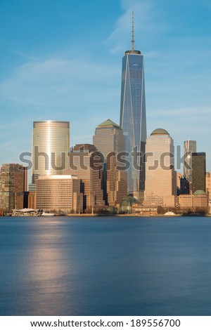 Lower Manhattan skyline at Sunset as seen from Exchange Place, New Jersey - stock photo
