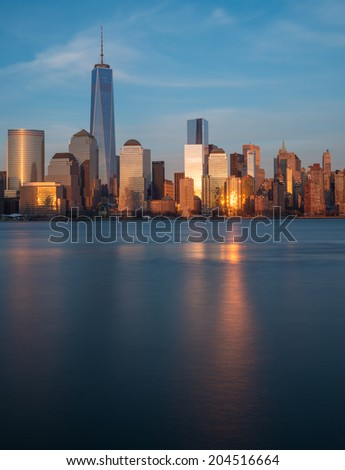 """Lower Manhattan skyline during """"blue hour"""" as seen from Exchange Place, New Jersey - stock photo"""