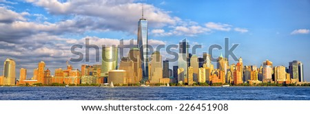 Lower Manhattan skyline panorama before sunset, New York - stock photo