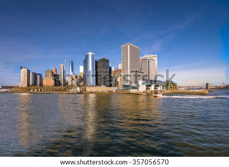 Lower Manhattan skyline panorama over East River with reflection. View from Staten Island - stock photo