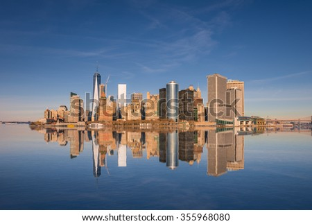 Lower Manhattan skyline panorama over East River with reflection. View from Staten Island New York - stock photo