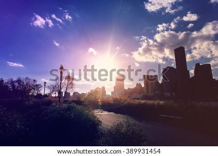 Lower Manhattanat sunset as viewed from Hudson River Park. - stock photo