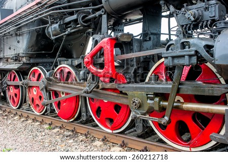 lower part of the locomotive on the railroad close up - stock photo