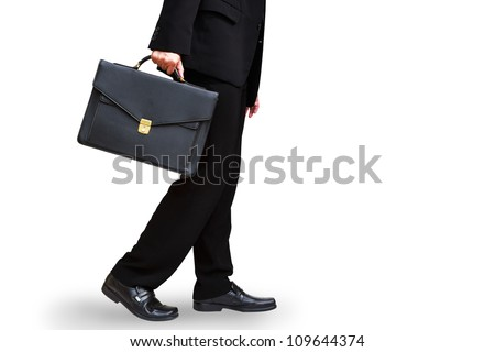 Lower section of business man hand holding briefcase, Isolated on white with clipping path