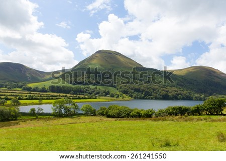 Loweswater Lake District Cumbria England UK with mountains in summer with blue sky and sunny weather - stock photo