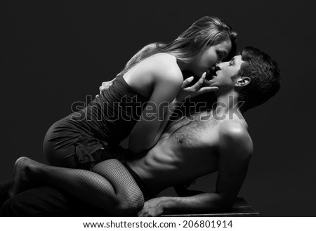 lowkey B and W portrait of a passionate couple - stock photo