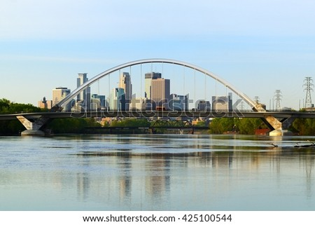 Lowry Avenue Bridge with Minneapolis, Minnesota Skyline - stock photo