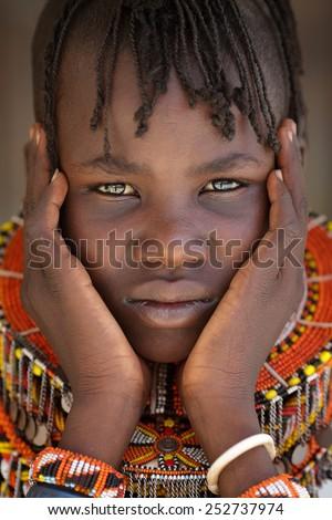 LOYANGALANI - KENYA - JANUARY 23, 2015: Unidentified beautiful Turkana girl with traditional necklace on January 23, 2015 in Loyangalani, Kenya.  - stock photo
