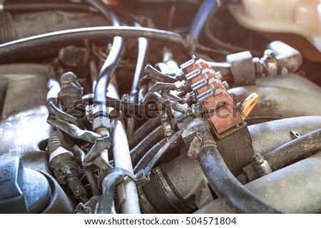 lpg car injectors in old car engine need to service, gas injector installed in gasoline engine to use cheaper alternative fuel.
