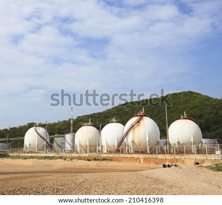 lpg gas tank storage in petrochemical heavy industry estate use for fuel power and energy topic  - stock photo