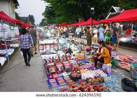 LUANG PRABANG, LAO - APRIL 5 : Walking Night Market, It's located on the main street. The market selling food, clothes and souvenirs and selected as World Heritage Site on April 5 , 2016.