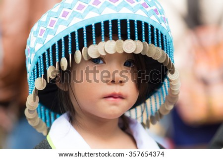 Luang Prabang, Laos - December 20, 2015: A little girl of local mountaineer tribe 'Hmong' is dressing with traditional costume in Luang Prabang, Laos. - stock photo