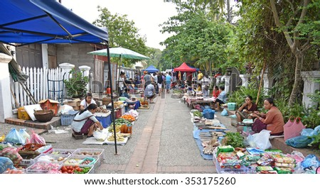 LUANG PRABANG, LAOS - MAY 4, 2015: Luang Prabang Morning Market is a popular sourvenir shopping site for tourists and sell the fresh food for local people.