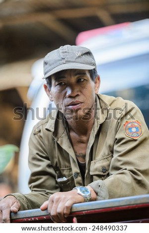 LUANG PRABANG, LAOS - SEP 25, 2014: Unidentified Lao man in a military form. 55% of Laos people belong to the Lao ethnic group