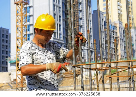 Luannan - August 21: Construction workers binding rebar in the construction site, on August 21, 2015, luannan county, hebei province, China