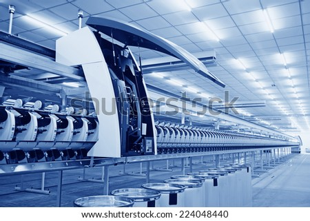 LUANNAN COUNTY - AUGUST 16: Spinning production line in a factory, on august 16, 2014, Luannan County, Hebei Province, China