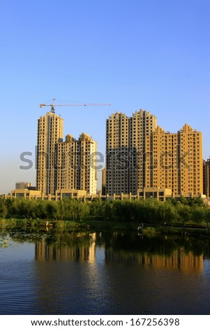 LUANNAN COUNTY, CHINA - AUGUST 30: The Unfinished high-rise buildings in the North River Park, on August 30, 2013, LuanNan county, Hebei province, China.