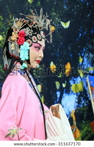 LUANNAN  COUNTY - DECEMBER 13: Chinese traditional PingJu woman showing classical costumes, on december 13, 2014, Luannan County, Hebei Province, China