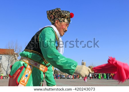 Luannan County- February 15: Chinese traditional style yangko folk dance performance in the street, on February 15, 2016, luannan County, hebei Province, China