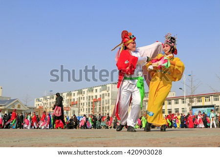 Luannan County- February 21: Chinese traditional style yangko folk dance performance in the street, on February 21, 2016, luannan County, hebei Province, China